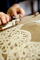 In the school of the Merletto a Tombolo, in Anghiari, women learn the art of bobbin lace or pillow lace (Merletto a Tombolo).  Here a women is weaving 100% linen thread with wooden bobbins known as 'fuselli or piombini'.