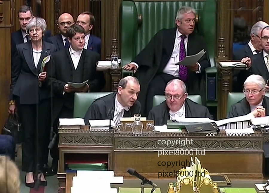 Pic shows:  Awkward!<br /> <br /> PM Theresa May enters the house before PMQs and throws under fire speaker John Bercow a glance before taking her seat.<br /> <br /> <br /> <br /> <br /> <br /> supplied by Pixel8000 Ltd