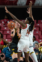 COLLEGE PARK, MD - FEBRUARY 13: Monika Czinano #25 sends the ball past Diamond Miller #14 of Maryland during a game between Iowa and Maryland at Xfinity Center on February 13, 2020 in College Park, Maryland.