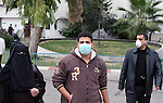 Palestinian men wear a protective masks as first cases of H1N1 flu infections have appeared, in Gaza City, 08 December 2009. According to the Health Ministery of the Hamas movement in Gaza, five people were infected by swine flu in Gaza City. Israel said Tuesday it is treating five suspected swine flu cases from Gaza in hopes of containing an outbreak of the virus in the blockaded Palestinian territory. Gaza health officials reported their first swine flu cases on Sunday. They say since then three people have died and nine others are hospitalized Photo by Wissam Nassar