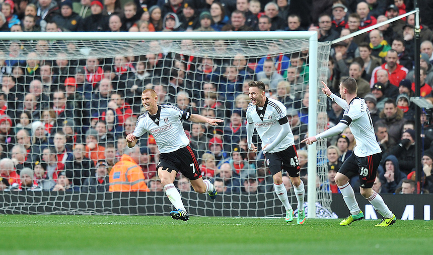 Fulham's Steve Sidwell (left) celebrates scoring the opening goal with team-mates Muamer Tankovic and Ryan Tunnicliffe<br /> <br /> Photo by Dave Howarth/CameraSport<br /> <br /> Football - Barclays Premiership - Manchester United v Fulham - Sunday 9th February 2014 - Old Trafford - Manchester<br /> <br /> &copy; CameraSport - 43 Linden Ave. Countesthorpe. Leicester. England. LE8 5PG - Tel: +44 (0) 116 277 4147 - admin@camerasport.com - www.camerasport.com