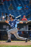 West Michigan Whitecaps left fielder Garrett McCain (10) follows through on a swing during a game against the Quad Cities River Bandits on July 23, 2018 at Modern Woodmen Park in Davenport, Iowa.  Quad Cities defeated West Michigan 7-4.  (Mike Janes/Four Seam Images)