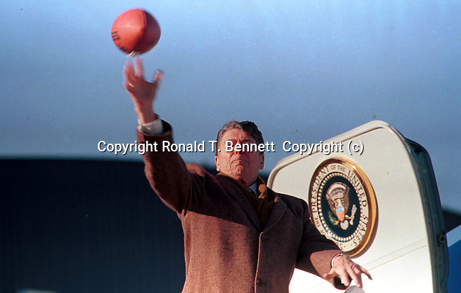 The gripper, President Ronald Reagan throws football from Air Force One, Photo by Ron Bennett, Photojournalism, Photojournalist, collecting editing,  News, sports, features, Hollywood, White House, Political,  presenting news photographs, Photojournalism provides visual support for stories, mainly in the print media,  Commercial photography's main focus is to sell a product or service, Fine Art photography are photographs that are created to fulfill the creative vision of the photographer, record of events, published, accurate, fair representation of events, facts, relatable, relate both content and tone, photojournalist is a reporter,Photojournalism, Political, News, Sports, Features, Hollywood