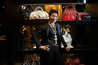 Portrait of Mrs. Sung-Joo Kim in front of MCM bags at the new MCM Shanghai flagship store on the Bund in Shanghai, China, on Tues., Jan 26, 2010.  A glamorous fashion line in the 1980s, South Korean billionaire Sung-Joo Kim has purchased the MCM luxury brand in hopes of reinvigorating the brand.  Now Sung-Joo Kim is trying to replicate the brand's Asian success in Western markets, part of a greater shift of Asian luxury brands being exported to American and European high streets.  The MCM Shanghai flagship store, located on the world-famous Bund in Shanghai, was opened on Tues., Jan. 26, 2010...CREDIT: M. Scott Brauer for the Wall Street Journal