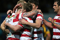 PICTURE BY VAUGHN RIDLEY/SWPIX.COM - Rugby League - Super League - Leeds Rhinos v Wigan Warriors - Headingley, Leeds, England - 01/06/12 - Wigan's Josh Charnley scores a try and celebrates with teammates