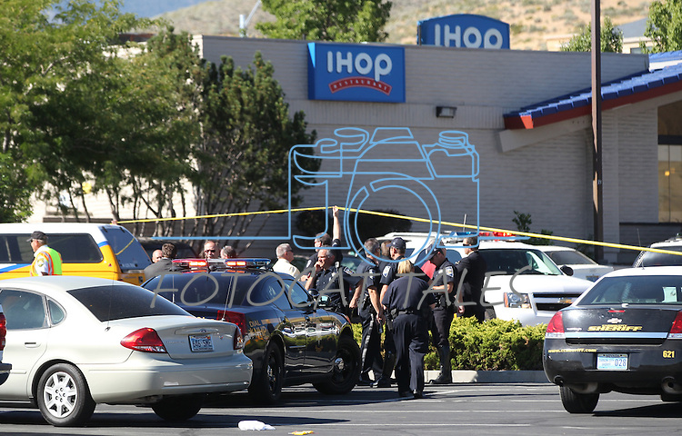 Emergency personnel respond to a shooting in an IHop restaurant in Carson City, Nev., on Tuesday, Sept. 6, 2011. (AP Photo/Cathleen Allison)