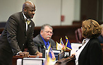 Nevada Senate Republicans Kelvin Atkinson and Debbie Smith work on the Senate floor at the Legislative Building in Carson City, Nev., on Friday, May 24, 2013. <br /> Photo by Cathleen Allison