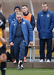 Ally McCoist pretending to put his foot outside the technical area for a laugh after being given a roasting from the ref