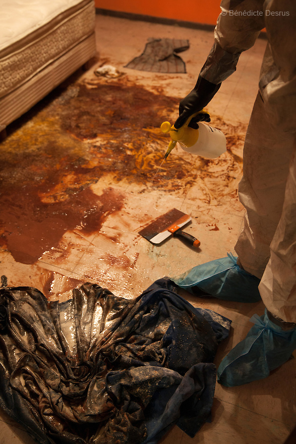 """Donovan using one of the 370 customized formulas which he has devised to carry out a forensic cleaning in Iztacalco, Mexico on October 16, 2015. The decomposed body of a man in his 60s was found in his bedroom a number of days after he died of a heart attack – although the deceased's own family members were unsure exactly how long he had been there. The victim's family remarked that the police had made unfounded insinuations against them, and had sought bribes. As a result they found Donovan's discretion and professionalism to be a welcome contrast. Donovan Tavera, 43, is the director of """"Limpieza Forense México"""", the country's first and so far the only government-accredited forensic cleaning company. Since 2000, Tavera, a self-taught forensic technician, and his family have offered services to clean up homicides, unattended death, suicides, the homes of compulsive hoarders and houses destroyed by fire or flooding. Despite rising violence that has left 70,000 people dead and 23,000 disappeared since 2006, Mexico has only one certified forensic cleaner. As a consequence, the biological hazards associated with crime scenes are going unchecked all around the country. Photo by Bénédicte Desrus"""