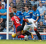 Bruno Alves, Lee Wallace and Fabio Cardoso tackle Dundee's Roarie Deacon
