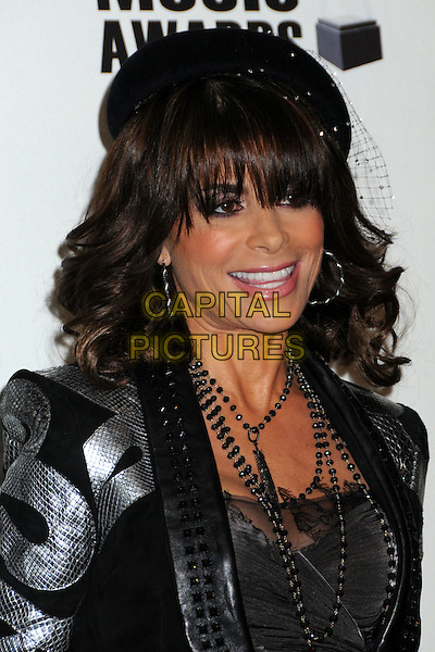 PAULA ABDUL .2009 American Music Awards Press Conference held at the Beverly Hills Hotel, Beverly Hills, California, USA..October 13th, 2009.headshot portrait black hat beret silk satin silver necklaces .CAP/ADM/BP.©Byron Purvis/AdMedia/Capital Pictures.
