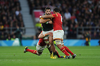 Damian de Allende of South Africa is tackled by Taulupe Faletau of Wales during Match 41 of the Rugby World Cup 2015 between South Africa and Wales - 17/10/2015 - Twickenham Stadium, London<br /> Mandatory Credit: Rob Munro/Stewart Communications
