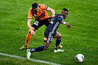 29th July 2020; Bankwest Stadium, Parramatta, New South Wales, Australia; A League Football, Melbourne Victory versus Brisbane Roar; Jack Hingert of Brisbane Roar grabs the shirt of Elvis Kamsoba of Melbourne Victory as he breaks inside