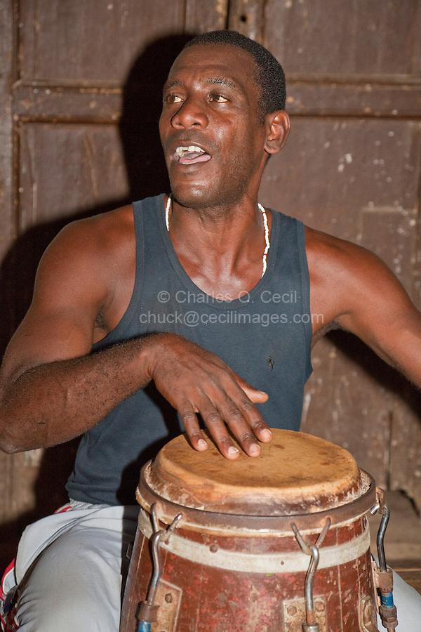 Cuba, Trinidad.  Drummer in Afro-Cuban Religious Ceremony of Congolese Origin.