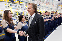 Torino: Luca Cordero di Montezemolo saluta gli operai dello stabilimento Maserati Gianni Agnelli Plant durante l'avvio della produzione della nuova Maserati Quattroporte...Turin:  Luca Cordero di Montezemolo President of Ferrari shakes hands with workers in the new Maserati plant dedicated to Gianni Agnelli. .It will produce the new model of Maserati Quattroporte.