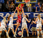 BROOKINGS, SD - FEBRUARY 22: Hannah Sjerven #34 of the South Dakota Coyotes lays the ball up between Tori Nelson #20 and Megan Bultsma #50 of the South Dakota State Jackrabbits Saturday at Frost Arena in Brookings, SD. (Photo by Dave Eggen/Inertia)