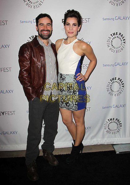 Jesse Bradford, Carly Pope.PaleyFest Icon Award 2013 Held At The Paley Center for Media, Beverly Hills, California, USA..February 27th, 2013.full length grey gray shirt brown leather jacket beard facial hair white sleeveless blue jeans denim lace ankle boots hand on hip dress.CAP/ADM/KB.©Kevan Brooks/AdMedia/Capital Pictures.