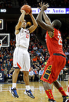 Virginia guard Malcolm Brogdon (15) shoots in front of Maryland forward Jonathan Graham (25) during the game Monday night in Charlottesville, VA. Photo/The Daily Progress/Andrew Shurtleff