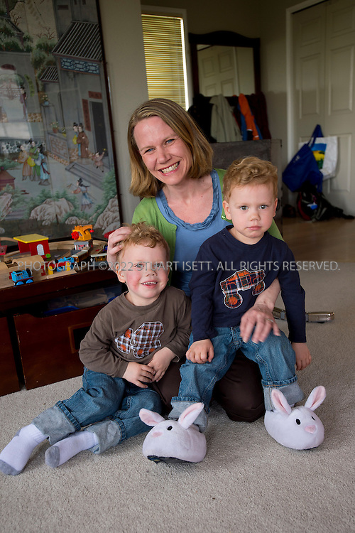 5/29/2012--Seattle, WA, USA..Eden Mack, 39, and her 2 yr old twins, Adrian (blue shirt) and Anderson (brown shirt) in their home in Seattle, WASH. Mack's children suffer from serious allergies to eggs and nuts. ....©2012 Stuart Isett. All rights reserved.