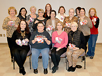 Janelle Jessen/Herald-Leader<br /> Members of the Siloam Springs and Gentry chapters of the Circle of Life Hospice Auxiliary gathered on Tuesday to put together more than 200 packages of Valentines cookies they baked for hospice staff members. The cookies will be distributed on Valentines day to hospice staff members at the Bentonville and Springdale locations as well as to mobile staff to thank them for their service, according to Kelly Horrell, giving manager for Circle of Life.