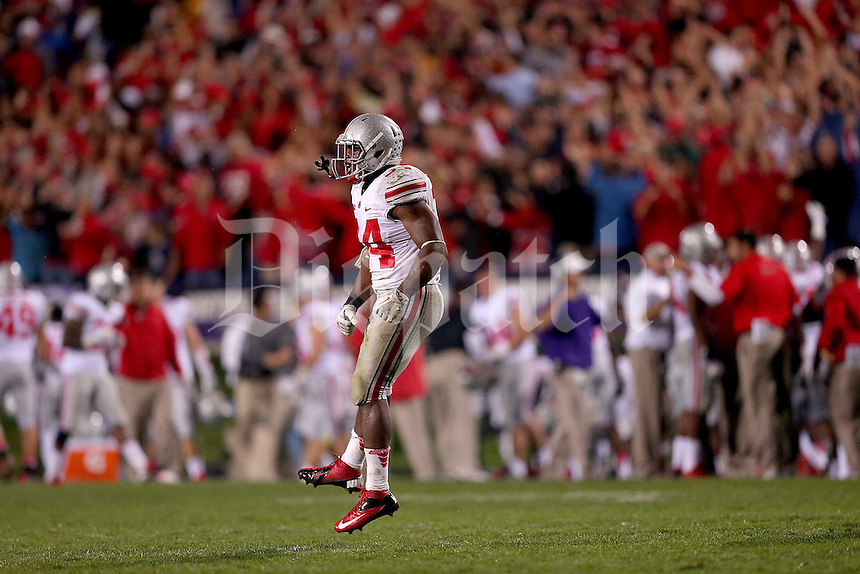 Ohio State Buckeyes running back Carlos Hyde (34) celebrates his reviewed touchdown during the second half of the NCAA football game between Ohio State and Northwestern at Ryan Field in Evanston, Illinois on Saturday, October 5, 2013. (Columbus Dispatch photo by Jonathan Quilter)