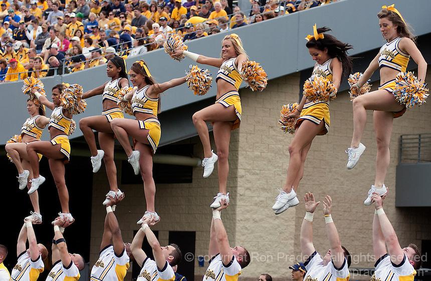 WVU cheerleaders. The WVU Mountaineers defeated the East Carolina Pirates 35-20 at Mountaineer Field at Milan Puskar Stadium, Morgantown, West Virginia on September 12, 2009.