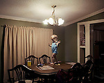 Evie, 2 years old, at the dinner table. Adger, Birmingham, Alabama.