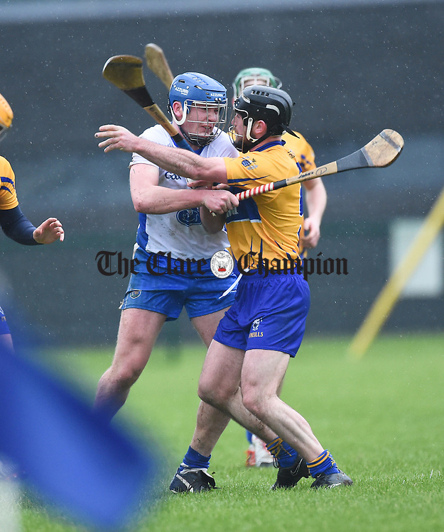 Micheal Harney of Waterford tussles with Gearoid O Connell of Clare during their Munster Senior Hurling League Round Four game at Carriganore. Photograph by John Kelly.
