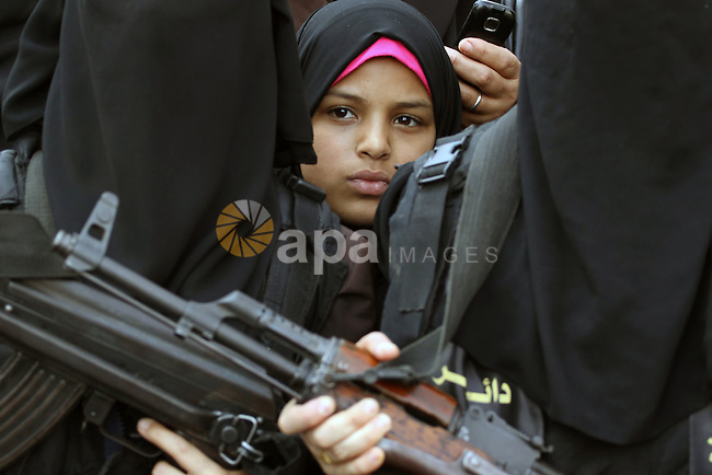 Palestinian female militants of the Islamic Jihad hold their weapons during a rally marking the 26th anniversary of the movement's foundation and marking the 18th anniversary of the death of the group's leader Fathi Shikaki, in Gaza City, Friday, Nov. 1, 2013. Shikaki, the founder of the Islamic Jihad group, was gunned down in Malta by a man on a motorcycle in an attack widely attributed to Israel. Photo by Mohammed Asad