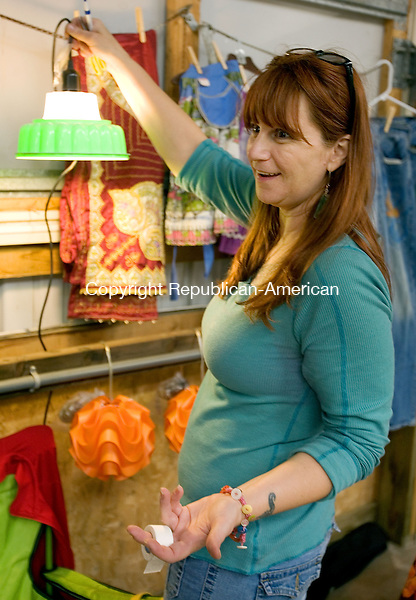 PLYMOUTH CT. 08 June 2013-060813SV12-Heather Wing of Thomaston holds up a Jell-O mold light she was selling at the 10th Annual Terryville Giant Flea Market &amp; Craft show at the Terryville Fairgrounds in Plymouth Saturday. Wing repurposes items and resells them with her business called remade in the USA.<br /> Steven Valenti Republican-American