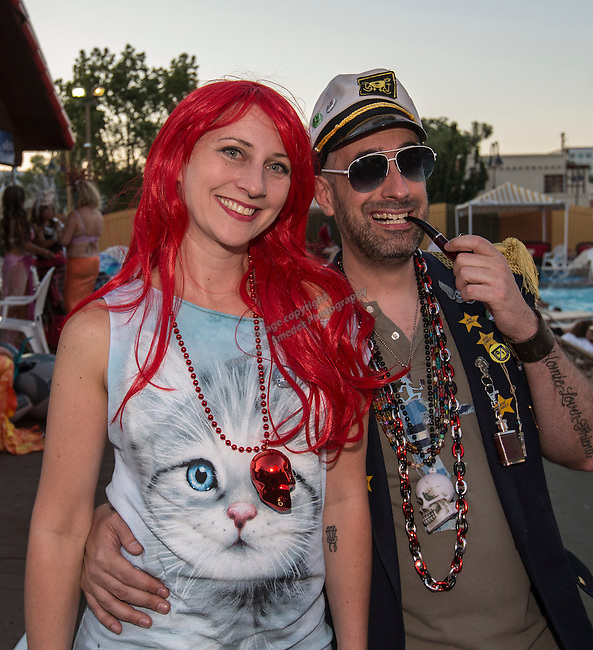 Crawl Reno organizers Heidi and Ed Adkins during the Pirate Crawl held in downtown Reno on Saturday night, August 13, 2016.