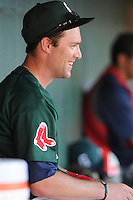 Outfielder Bryce Brentz (25) of the Greenville Drive is congratulated in the dugout after extending his hitting streak to 26 games against the Charleston RiverDogs on May 15, 2011, at Fluor Field at the West End in Greenville, S.C. Photo by Tom Priddy / Four Seam Images