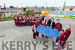 Moyderwell primary school staff and pupils were delighted to raise their hard earned Blue Flag on Friday morning. Pictured at the front were: Aoife Hartnett, Vanessa Horvathova, Sara Peterniece, Jim Finucane (Mayor of Tralee and Chair of the school), Moira Quinlan (Principal), Cillian Griffin, Sophie Kerins and James Wong.