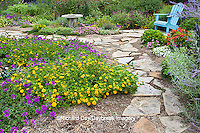 63821-19404 Flower garden with stone path, blue chair, birdbath. Homestead Purple Verbena, yellow lantana, Russian Sage, Gomphrena IL
