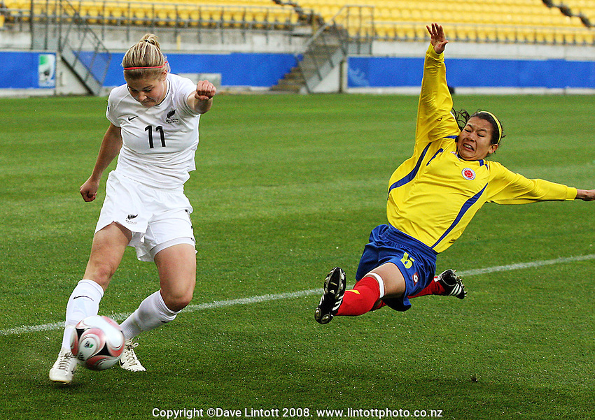 Columbia's Edna Mendez launches herself at Rosie White during the FIFA Women's Under-17 World Cup pool match between New Zealand and Columbia at Westpac Stadium, Wellington, New Zealand on Tuesday, 4 November 2008. Photo: Dave Lintott / lintottphoto.co.nz