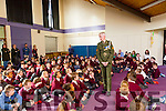 Sergeant Chris Hoare speaks to pupils of Holy Family School Tralee on Monday when he delivered the tricolour and Proclamation to Holy Family School Tralee to commemorate the 100 year anniversary on Monday