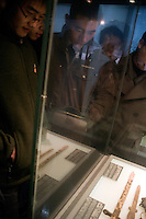 People look at artifacts uncovered in a mass grave of victims of the Nanjing Massacre at the Memorial Hall of the Nanjing Massacre in Nanjing, Jiangsu, China on Dec. 13, 2009.  Weapons used in the killing were found in the mass grave. On Dec. 13, 2009, thousands of people visited The Memorial Hall of the Nanjing Massacre in Nanjing, Jiangsu, China, to remember those who died at the hands of Japanese soldiers in 1937-8.  The day marked the 72nd anniversary of the start of the massacre. The historical account has always been mired in controversy, and differing opinions on what actually happened have been a consistent obstacle to relations between China and Japan.  China's official account of history states that 300,000 people were killed by Japanese forces over a 6-week period starting Dec. 13, 1937