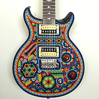 """Carlos Santana's guitar hangs on the wall in the """"Wood Library"""" at the Paul Reed Smith guitar factory on March 20, 2013"""
