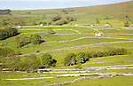 Old barns and dry stonewalls, Malham, Yorkshire Dales national park, England, UK