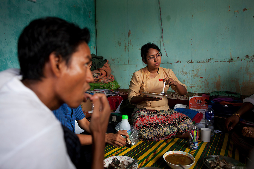 National League for Democracy (NLD) candidate Phyu Phyu Thin eats with other NLD party members at an NLD office after a day of campaigning in Mingalar Taung Nyunt township, in Yangon, Myanmar, March 23, 2012.