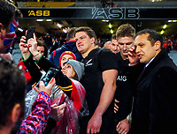 The Barrett brothers (from left, Scott, Beauden and Jordie) are swamped by fans after the 2017 DHL Lions Series rugby union 3rd test match between the NZ All Blacks and British & Irish Lions at Eden Park in Auckland, New Zealand on Saturday, 8 July 2017. Photo: Dave Lintott / lintottphoto.co.nz
