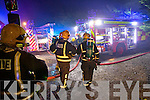 Firemen at the scene of a house fire in Ashill outside Tralee on Tuesday evening.
