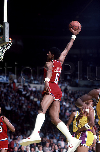 "1986-87:  Julius Erving, ""Dr. J"", of the Philadelphia 76ers goes up for the slam dunk during a Sixers game versus the Los Angeles Lakers at the Great Western Forum in Inglewood, CA.."