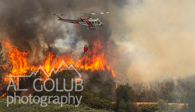 Cal Fire helicopter 404 at the Flat Fire started on Highway 49 near Moccasin and burned up hill toward Priest Dam. Photo by Al Golub