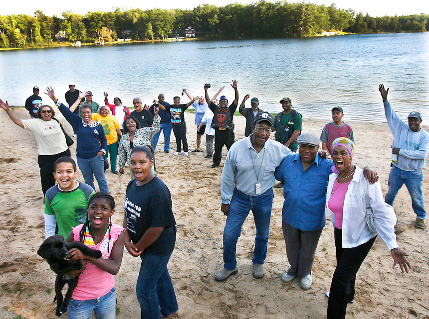 Many from the community of Idlewild, Mi., gather on the beach on Williams island.