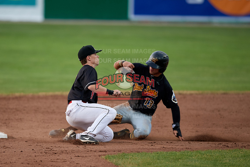 Batavia Muckdogs second baseman Luke Jarvis (8) puts a tag on Travis Swaggerty (13) during a game against the West Virginia Black Bears on July 2, 2018 at Dwyer Stadium in Batavia, New York.  West Virginia defeated Batavia 3-1.  (Mike Janes/Four Seam Images)