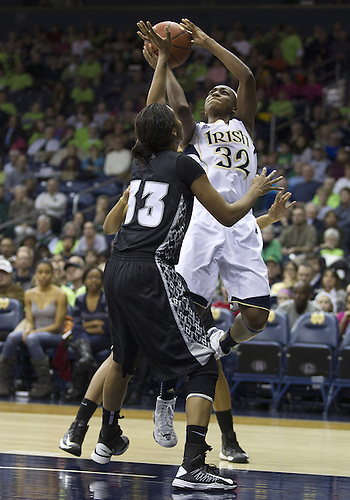 January 26, 2013:  Notre Dame guard Jewell Loyd (32) goes up for a shot as Providence forward Brianna Edwards (33) defends during NCAA Basketball game action between the Notre Dame Fighting Irish and the Providence Friars at Purcell Pavilion at the Joyce Center in South Bend, Indiana.  Notre Dame defeated Providence 89-44.