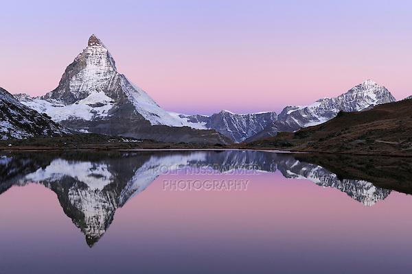 Matterhorn at sunrise in winter with reflection in the Riffelsee, Zermatt, Valais, Switzerland, Europe