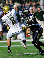 20 September 2008:  FIU defensive lineman Jonathan Betancourt (94) puts pressure on South Florida quarterback Matt Grothe (8) in the first quarter of the USF 17-9 victory over FIU at FIU Stadium in Miami, Florida.