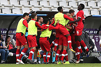 The Canadian substitutes and coaching staff mob Thelonius Bair after scoring their opening goal during Japan Under-21 vs Canada Under-21, Tournoi Maurice Revello Football at Stade Parsemain on 3rd June 2018